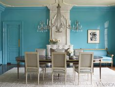 """The variations create a subliminal rhythm,"" says Kasler, whose second book, Timeless Style (Rizzoli), comes out in October. ""There's a lot of color, but it's strategically used, so it ends up feeling subtle."" A vibrant turquoise defines the dining room, from the walls and upholstery to the fine trim on the chairs. Chandelier, David Iatesta. Table, Suzanne Kasler for Hickory Chair. Rug, Beauvais. Art, Franz Kline. Ceiling, Ralph Lauren Paint's Oyster.   - Veranda.com"