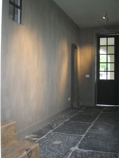 Beautiful wall with Chalk Lime Paint to create a concrete look. Stunning deep gray natural stone floor as well.