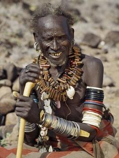Kenya, Rift Valley Province, Tum. An old Turkana medicine man. His wooden necklaces are charms to ward off evil spirits.