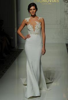 Pronovias wedding dress with asymmetrical lace bodice, white sheath style skirt with chapel train Fall 2016 | https://www.theknot.com/content/pronovias-wedding-dresses-bridal-fashion-week-fall-2016