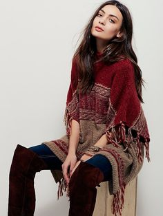 Labryinth Poncho | Super soft mock neck sweater poncho featuring a stripe, tribal inspired design.  Fringe detailing and side vents.