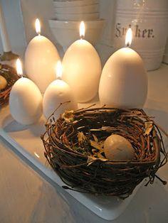 {egg shaped candles on platter}