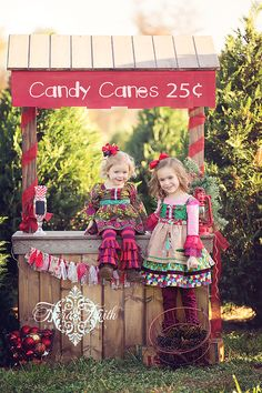 A Christmas photo shoot at a tree farm is a super cute idea!  Add a candy cane stand and it becomes a super super cute idea!