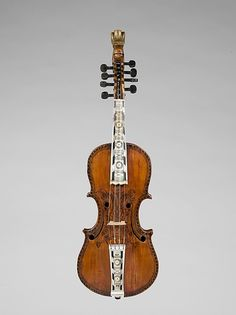 Hardanger Fiddle Date: 1786 Geography: Norway Culture: Norwegian Medium: Wood, mother-of-pearl, bone Dimensions: Overall: 62 cm (24 7/16 in.) Classification: Chordophone-Lute-bowed-unfretted Credit Line: Purchase, Frederick M. Lehman Bequest, 2008 Accession Number: 2008.268