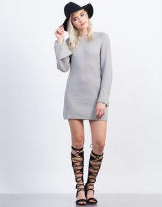 Stay cozy this Winter in this Bell Sleeve Sweater Dress. It works both as a tunic or a dress. Features a small scoop neck, bell sleeves, and falls at about knee length. Looks perfect paired with over-the-knee boots and a wool hat.