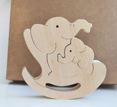 Mother's day gift Wooden Puzzle elephant Wooden Swing toy Kids gifts Animal puzzle elephant Family W Woodworking Patterns, Woodworking Projects, Wooden Elephant, Animal Puzzle, Wooden Swings, Elephant Family, Wooden Shapes, Scroll Saw Patterns, Wooden Puzzles