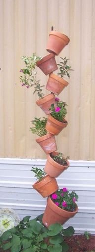 Clever and easy to do, space saving annual flower pots.  Take a 4 high tomato stake, and your clay 6 pots.  Place the stake in the ground at least 12, then put the drainage holes in bottom of pots through stake and tip, creating a zig zag pattern.  Fill with soil and your favorite annuals.  Anything cascading or trailing works well like Bacopa, trailing petunias, vinca, million bells, etc.