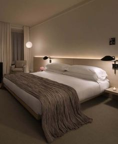 Interesting wall lights as well as the led headboard light make this bed modern and chic. http://laboheme.life