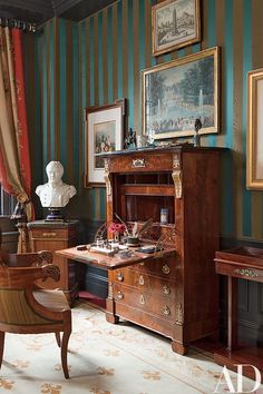 An Empire secrétaire à abattant and a bust of Napoléon stand in the guest room; the walls are covered with a Claremont stripe.