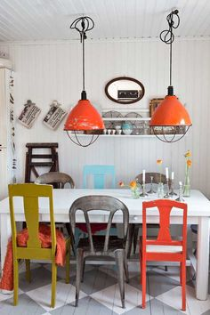 I completely love the mix up of colour and all these mismatched chairs - it's great!
