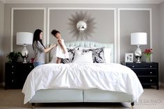Love the moulding, white linens, black nightstands, shiny lamps... okay, i'll take it all.