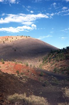 Clouds above the red and black slopes of Sunset Crater - along the Lava Flow Trail