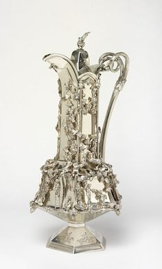 Claret Jug By Angell, Joseph (the younger) made 1851 The firm of Joseph Angell and Son was one of the largest and most important silversmithing and jewellery, manufacturers and retailers in London in the mid 19th century. Its origins can be traced back to the late 18th century when Joseph Angell was apprenticed to Henry Nutting, goldsmith of Noble Street, on October 5, 1796. Joseph Angell entered his first mark as a plateworker at the London Assay Office on October 7, 1811.
