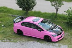 HAHa I kinda like this a lil too much. kills me that it's a civic though. maybe a celica with the spoiler in pink and black.. (?)