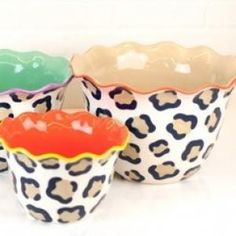 Make a bold statement with the Leopard Ruffle Dizzy Bowl Set. Sophisticated and sleek, the set pairs unexpected hues with distinctive ruffle details creating elegant edge. Ideal for prepping and serving, each bowl easily transitions from countertop to tabletop and creates a striking centerpiece with exotic appeal.