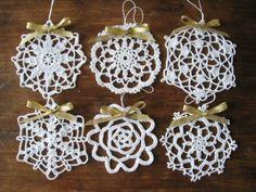 Crochet White Snowflake Ornaments Wall Hanging Home Decor Modern Wall Art Christmas Decorations. $18.00, via Etsy.