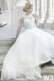 Vintage lace bridal gown with high illusion neckline ballgown tulle skirt and keyhole back.