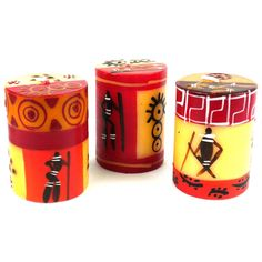 This set of three candles handpainted by South African artisans arrives in a recycled cardboard gift box.  Each candle is 2.5 inches tall by 1.75 inches in diameter.