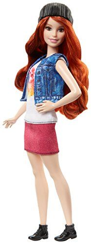 Barbie Fashionistas doll wears a hip look that has a kitty decal on the bodice a drop-waist pink skirt and denim vest...