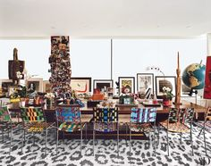 Surrounded by Franz West chairs, the Émile-Jacques Ruhlmann table in Diane von Furstenberg's Manhattan office/living area often does double duty as a desk and dining table.   archdigest.com
