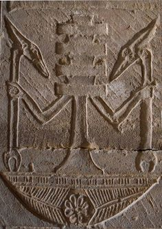 Personified Djed pillar standing on the neb basket and holding two Was-scepters. Detail from the Temple of Hathor at Dendera
