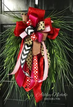 """A cute simple design, Our Valentine Grass Wreath features various bright green grasses and a gorgeous bow! This is a great wreath to use other holidays also by changing the bow! Built on a 24"""" oval grapevine wreath,Diameter of wreath is 26-29"""" from tip to tip."""