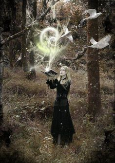 Gypsy Moon Goddess. Magic coming out of a book. I could not find the artist's page.