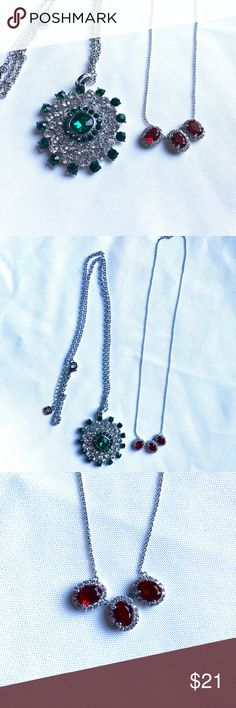 Emerald and Ruby Necklace 💎You will receive two beautiful necklaces. One starburst long  chain necklace with emerald accents and a stunning triple ruby accent silver chain necklace. 💎 Jewelry Necklaces