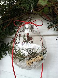 "Greenery, berries, ""snow,"" and letter blocks inside clear glass ornament. Plus 25 ways to decorate clear ornaments."
