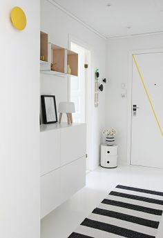 White hallway with Besta from IKEA and Componibili by Kartell
