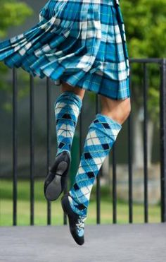 Kilt & hose from the waist down from the side #yarrow #turquoise #tartan    To me, this looks like a male dancer. Anyone else want to weigh in?