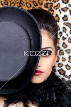close-up of a indian fashion model posing with a hat. - Close-up portrait of a gorgeous Indian fashion model posing with a hat, Model: Kiran Bahugun