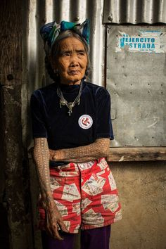 Captivating photo of a 94yo tattoo artist who lives deep within the depths of the Philippines. Her name is Fang (Whang)-Od. Those tattoos are traditional Filipino tribal designs, an art form dating back to the pre-Spanish occupation.