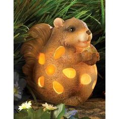 Chipmunk Garden Solar Light    http://www.bonanza.com/listings/Chipmunk...      Priced $18.90. Categorized under Home & Garden >> Yard, Garden & Outdoor Living >> Garden Decor >> Other. Condition: New, Material: Resin , Main Color: Brown . Chuby chipmunk chuckles with gle as he holds his treasured acorn for al to se Adorable solar powered light ads a bit of wodland whimsy to y…