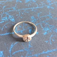 Designer Satya Peace Sign Ring 925  SZ 8.75 Sterling silver designer Satya PEACE ring SZ 8.75. This ring is a great layering ring and great for those who prefer dainty jewelry. Extremely comfortable to wear. You'll love this ring!! Satya Jewelry Rings