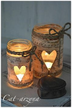 Music sheet wrapped candle jars; Sydney found this--she might have just found next year's band banquet centerpiece idea! ♪♫