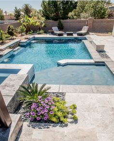 A stunning modern pool with stone accents, sun shelf tanning ledge and raised spa is the backyard retreat you need. http://www.anthonysylvan.com/browse-pools-spas/pool-designs/geometric-pool-designs/