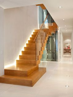 Lighting, Contemporary Wooden Staircase Style With Adorable Staircase Lighting Design And Glass Stair Divider Also Cool White Tile Floor And Modern Ceiling Lights: Enchanting Staircase Lighting Ideas