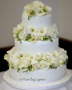 Wedding Cake A Tiered Design With White Roses Tulips And Freesias  cakepins.com