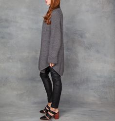 5c83b0b7ea Oversized chunky knit sweater dress with rounded hem details. Dark Charcoal  gray yarn with rice-stitch and extra-long sleeve detail