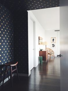 Master bedroom entryway, with Crescent Moons wallpaper by Bartsch, from Paris.