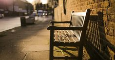 Brown Wooden Bench on the Side of the Road · Free Stock Photo