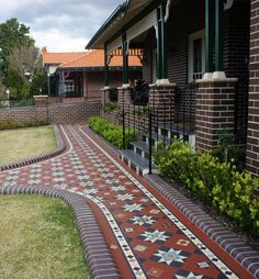Love these Victorian Geometric tiles in this heritage house Olde English Tiles - Beautiful Verandah Heritage Tessellated Tiles. Love these Victorian Geometric tiles in this heritage house Terrace House Exterior, Victorian Terrace House, Compound Wall Design, Porch Tile, Victorian Front Doors, Front Verandah, Driveway Design, Melbourne House, Brick Facade