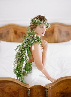Open Back Wedding Dress with a Trailing Green Garland and Crown   Jacque Lynn Photography and Michelle Leo Events   Enchanting Woodland Wedding Shoot with Rustic Winter Details