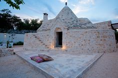 The distinctive conical-roofed trulli characteristic of Puglia, Italy, were shepherds' houses in centuries past. Today, these charming structures have become desirable renovation and restoration projects being transformed into some of Italy's most luxurious rental villas. / http://homes.ninemsn.com.au/2016/03/18/10/30/puglia-luxury-trulli#hhOjdtmHfegziPqC.99