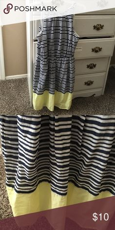 Old Navy dress High neck, keyhole opening in back with button. Summery striped print with color block at the bottom. Navy and white striped with yellow. Size small, tag still on. Old Navy Dresses