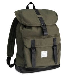 Khaki green canvas backpack with faux leather details, drawstring & flap closure with metal buckles. | H&M For Men