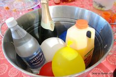 ice bucket full of frozen water balloons, great party trick to avoid tons of dripping bottles.
