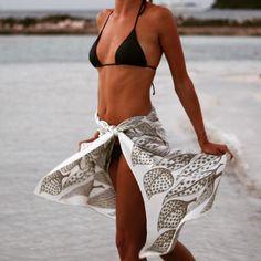 """You can never go wrong with the classics...a Lotty B #sarong and a @pinkhousemustique #bikini. #beachwear #beachfashion"""
