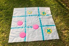 Make a giant tic-tac-toe game board for a small sum. Mark a grid on a shower curtain liner with duct tape, then make X's on 4 Frisbees or plastic plates and O's on 4 more disks. Set up a throw line and let the play begin!